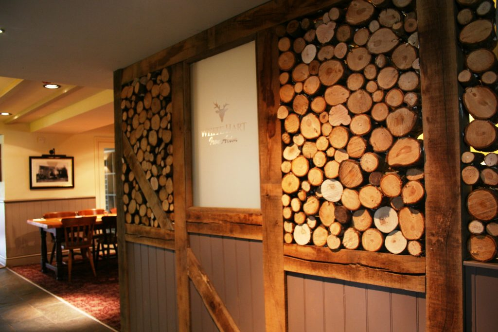 log wall at The White Hart pub Iron Acton
