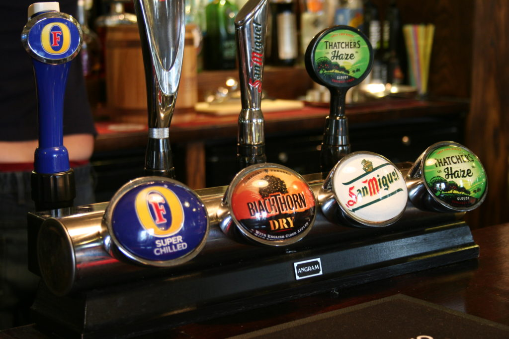 beer pumps at The White Hart pub Iron Acton