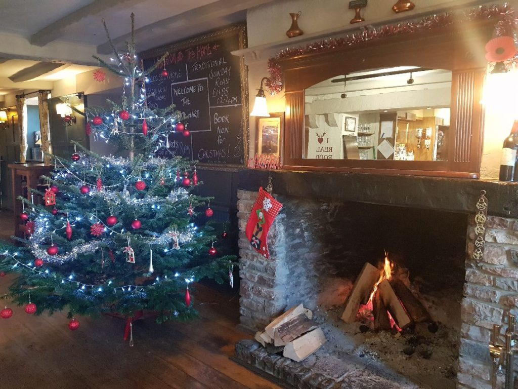 christmas fireplace and christmas tree at The White Hart pub Iron Acton